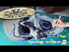 Painting a surfboard with a tattoo-style screaming skull design using spray paint and paint markers - YouTube