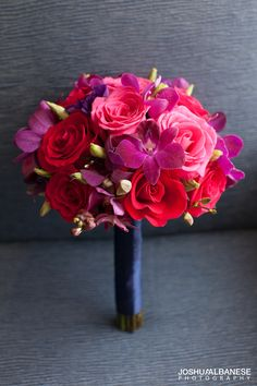 Red bride bouquet with mix of roses and orchids. #flowers #bouquets #wedding #bride