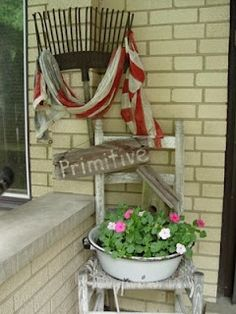 Old chair with a bucket of flowers on the porch