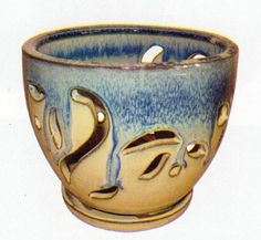"""Beige and Blue Ceramic Orchid Pot and Saucer 5 3/4"""" x 4 3/8"""" by Hirts: Pots. $9.99. Great for most orchids. Attractive Design plus felt feet for scratch prevention. 5 3/4"""" x 4 3/8"""". Attached saucer/humidity tray. Heavy Glazed Ceramic Pot. These orchid pots are as functional as they are beautiful. They are crafted with unique patterns carved into them for proper air ventilation to your root system, essential for thriving orchids. With a variety of shapes, pattern..."""
