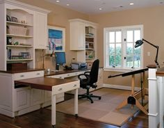 Organized Office.  Wall of Built in cabinetry with desk, and a great faux drawer that pulls out for extra work space.  Brilliant!