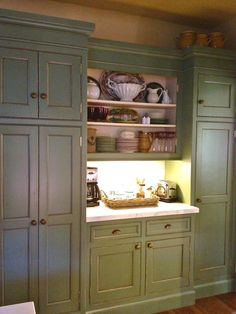 This is a wonderful blog. Love the built in pantry and coffee/breakfast station.  http://1.bp.blogspot.com/-DCJ4K-kV-7Y/T-x0eT5t-FI/AAAAAAAAThE/e8v6pdwyGLE/s1600/IMG_0969.jpg