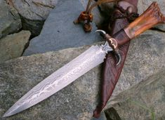 """Picture 8 1/2"""" blade hand forged from my own pattern welded(damascus) steel.Blade has 80 layers of 1095 & 15N20.Copper guard with iron claws.Handle is desert ironwood,copper,and waterbuck bone."""