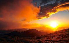 sunlight sunset sunrise nature landscapes mountains hills sky clouds glow ocean sea