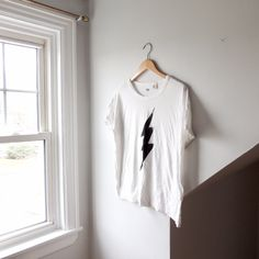 31012968 @lisaloveslions on Depop Levi's Lighting bolt graphic tee Size Medium White  cotton tshirt by Levi's