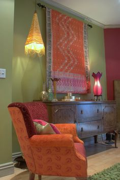 Repurposed vintage furniture from Designers Guild fabric from Jane Hall Design.Upholstered vintage arm chairs sell from 1200.00-1800.00 . Custom made silk lamps 200-400 and a beautiful  Indian saree I transormed into a wall hanging and throw for 300.00