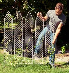 Italian designer Andrea Rekalidis has re-imagined the bucolic white picket fence as a portable and durable metal trellis! He might have just re-imagined the plan for my garden fence as well!  Does it look chicken-proof?