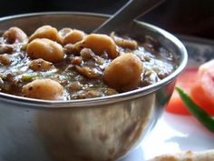 The famous chhole recipe from the streets of Delhi: Punjabi style chickpeas. There are a lot of copies of this one floating all around, this one is the original! ;-)