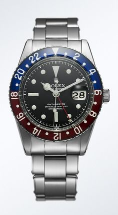 An early Rolex GMT-Master wrist chronometer from the 1950s, featuring the red and blue, 24-hour graduated rotatable bezel indicating the daytime and night-time hours of a second time zone. The bezel insert was made of Plexiglas that was painted underneath.