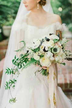 Bride's Bouquet Showcasing: White English Garden Roses, White Anemones, White Sweet Peas, White Roses, Champagne Roses, Dark Blue Privet Berries, White Astilbe, Blushing Bride Protea, Green Sword Fern & Other Greenery/Foliage ^^^^