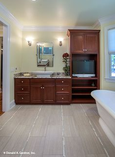 This master bathroom is made for relaxing! The Kenningstone #1166. http://www.dongardner.com/house-plan/1166/the-kenningstone. #Bathroom #MasterBathroom #Luxury
