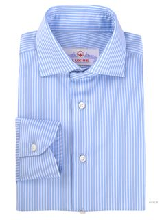 Luxire dress shirt constructed in White Pencil Stripes on Light Blue: http://custom.luxire.com/products/alumo-white-pencil-stripes-on-light-blue Details  Collar: 3″ collar points, 5″ spread, 1.25″ front band height, 1.625″ rear band height, 2″ rear collar height, 3/8″ tie space  Cuffs: 1 button cuffs.