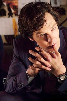 This has it all. His beautiful hands, fingers touching those to die for lips, those gorgeous eyes and those curls. He's perfect. ---> (what she said times infinity!)