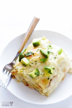 This White Chicken Enchilada Casserole is simple to make, full of a cheesy chicken and white bean filling, and made with a lighter cream sauce.