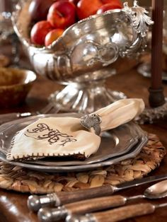 Pewter, bone handled flatware, owl napkin ring and woven mat, equals a simple, eloquent, woodsy setting for use all fall long.
