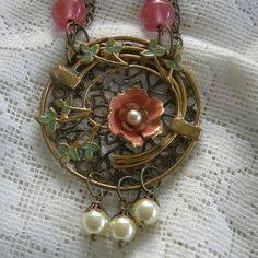 Repurposed Krementz Brooch Assemblage Necklace in Salmon And Green by Vintagearts on Etsy https://www.etsy.com/listing/244989875/repurposed-krementz-brooch-assemblage
