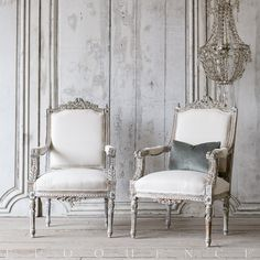 Vintage Armchairs: 1940 Fabulous Pair of Louis XVI Style Armchairs in dusty blue finish. Heavily carved frame in beautiful detail, upholstered in white duct canvas fabric.
