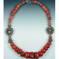 This necklace was crafted by store co-owner Emily Hunter Silverman. She used antique coral, sterling silver and vintage paisley plaque pieces. Necklace measures 18 inches with a Bali silver toggle cla