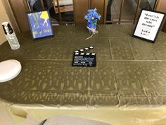 Our La La Land themed party! I printed the pictures and put them in frames, ordered the board, and starry cups and plates from Oriental Trading, and a gold tablecloth from Target! The faux flowers are from Old Time Pottery.