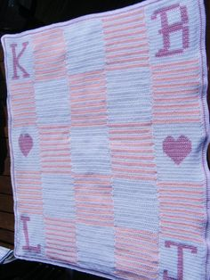 This Blanket was done in single crochet with the letters and hearts cross stitched on afterwards I then sewed a piece of fleece on the back to make extra warm and soft.
