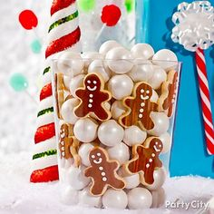 Make a yummy tub of Christmas eye candy with a clear container, snowy white gumballs and mini gingerbread men - nom nom!