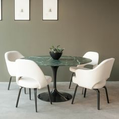 Cool Interior Paint Color And Wall Art With Saarinen Table Also Saarinen Executive Armchair And Round Marble Top Dining Table Plus Centerpiece For Tile Flooring Dining Room Design
