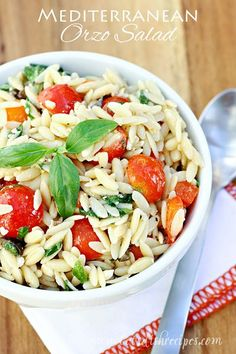 Mediterranean Orzo Salad   This light pasta salad is loaded with spinach, tomatoes, olive, peppers and feta cheese, with a vinegar and oil dressing.