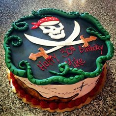 Pirates! #cake #pirate #treasure #skull #crossbones #map #bandana #lagoon…
