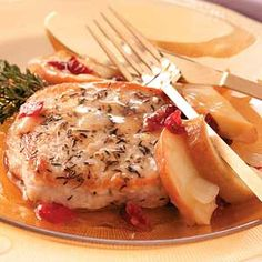 These chops are dressed up with a fragrant herb run and served with a sweet apple and cherry sauce.