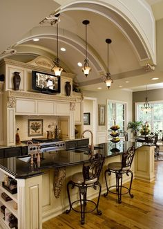 Like the colors and the arch and counters. Don't like the  swirl wood details