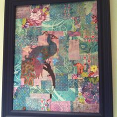 Decoupaged canvas with scrapbook paper and placed in an old frame  Whoah, my peacock!  cool idea with other scrapbook papers.  Maybe I could imitate the sari patchwork fabric i have elsewhere.