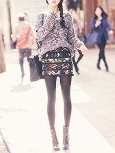 Bodycon skirt, loose sweater, tights, and  ankle booties. A super cute outfit.