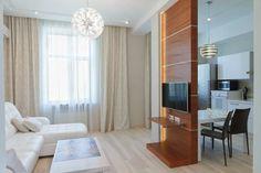 Térelválasztó kis lakásban nappali és konyha között