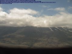 This is a static, near real-time image of Mount St. Helens, taken from the Johnston Ridge Observatory. The Observatory and VolcanoCam are located at an elevation of approximately 4,500 feet, about five miles from the volcano. You are looking approximately south-southeast across the North Fork Toutle River Valley. The VolcanoCam image automatically updates approximately every five minutes.