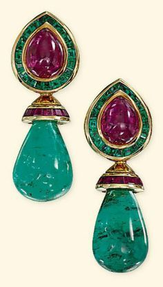 A pair of emerald and ruby ear pendants by Hemmerle, Each composed of an emerald bead drop to the calibré-cut ruby-set cap suspended from a similarly-set surmount mounted with a pear-shaped cabochon ruby. Emerald Earrings, Emerald Jewelry, Gold Jewelry, Vintage Jewelry, Fine Jewelry, Drop Earrings, Jewellery Box, Peridot Earrings, Green Earrings