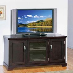 <li>Holds TVs up to 50-inches</li><li>Adjustable shelves for components</li><li>Bronze hardware with highlights</li>
