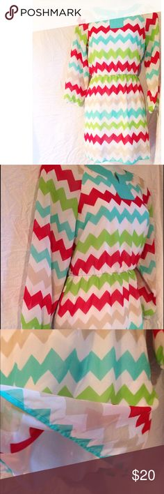 MyMichelle chevron dress chevron print, sinched waistline, long sleeved sheer material with a white lining inside. Very pretty! Bright and fun :) size 16 mymichelle Dresses Midi