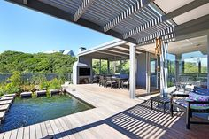 #WowKleinSlangkop Kommetjie Beach Home in nature 5 mins walk from beach  This Luxury Self Catering 4 Bedroom Accommodation in Kommetjie is a modern Cape Cod self-catering holiday home in Kommetjie sleeps 8. It's a lovely open-plan holiday home in the secure Klein Slangkop Private Eco- Estate.  There's a lot I like about this house but have a look at the milkwood trees  around the house and its eco-pool to absorb the spirit of this house: green and serene. Outdoor Couch, Outdoor Decor, Cape Town Holidays, 8 Seater Dining Table, Relaxing Holidays, Upstairs Bedroom, Holiday Accommodation, Beautiful Lights, Family Activities