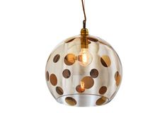 ROWAN Dots Pendant (gold)- is produced in 4 sizes in a selection of warm shades of mouth-blown glass, combined with metal fittings and twisted fabric wire in silver and brass.