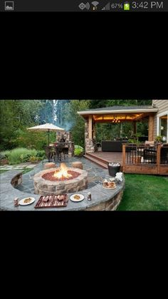 Back deck walking out to firepit with stone surrounding the upper wooden deck