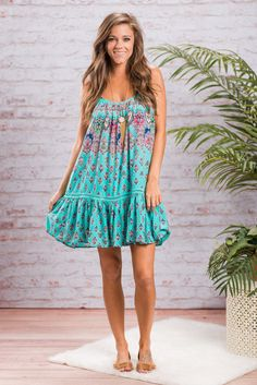 This dress is so fabulously boho! We love all those bright colors and that funky fun print!! This dress has an excellent amount of flare from the way it's gathered at the neckline! This dress is fully lined since it does have a crochet strip that is see through around the bottom.