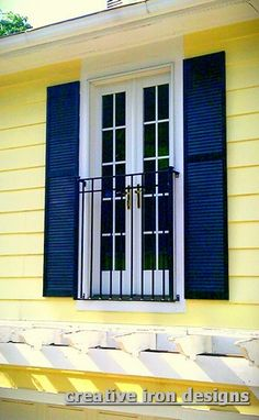 """French door, Juliette balcony;  Creative Iron Designs - This does not make sense to me, the shutters would not be functional.  Even faux shutters should """"look"""" like they are real."""