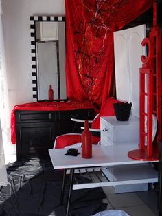 Renovation of old furniture. Painting in black and white with red-added elements.