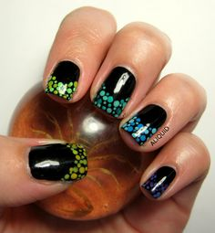 OK, how do I describe this one?  First, it's absolutely stunning!  Black mani with gradient dotticure tips, also skittle-ized from purple, blue, green.  Yummy!