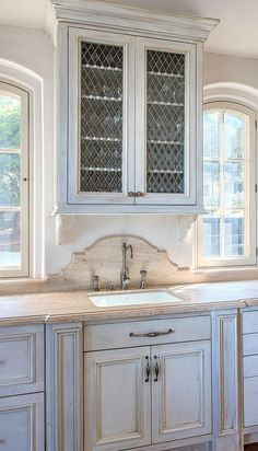 Love the back splash, so refreshing instead of seeing so much subway tile in kitchens....