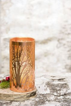 Copper Candle Holder with Intricate Cutouts of a Winter Woodland