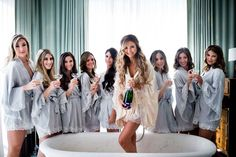 Matching bridal party robes = wedding goals.   A Lavish Garden Wedding at a Private Residence in Miami, FL https://www.thecelebrationsociety.com/weddings/a-lavish-garden-wedding-at-a-private-residence-in-miami-fl/