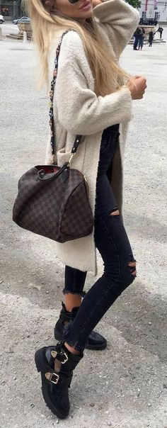 Winter white cardigan over black with brown and black bag.