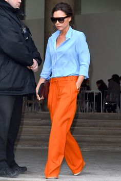 Who: Victoria Beckham What: Bold Trousers Why: Beckham's approach to style is always streamlined, but the designer also had fun with color recently in Paris, mixing orange trousers with a blue button down from her own collection.