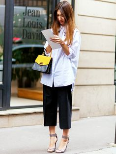 Wear an oversized button-down shirt with wide-leg cropped trousers, and accessories with a top-handle bag and high-heeled sandals. // #TipOfTheDay